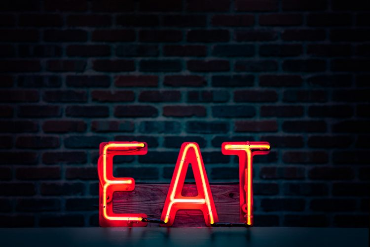 Time restricted eating neon eat sign